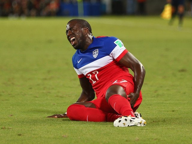 USA striker Jozy Altidore lies injured during his side's match with Ghana on June 16, 2014.