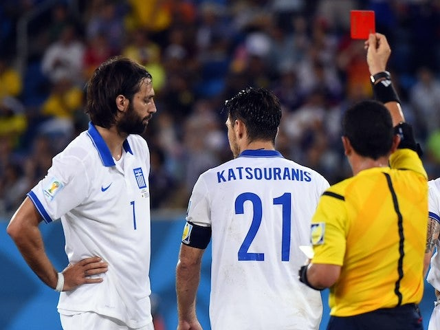 Greece's midfielder Kostas Katsouranis (C) is given the red card after a foul on Japan's midfielder Makoto Hasebe during a Group C football match on June 20, 2014