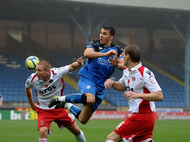 Lee Gregory of Halifax Town rises for a header with MIchael Morrison of Charlton during the FA Cup sponsored by Budweiser First Round match between Halifax Town and Charlton Athletic at the Shay on November 13, 2011