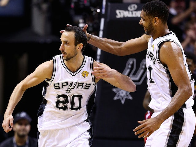 Manu Ginobili (L) and Tim Duncan of the San Antonio Spurs celebrate during game five of the NBA Finals against the Miami Heat at the AT&T Center on June 15, 2014