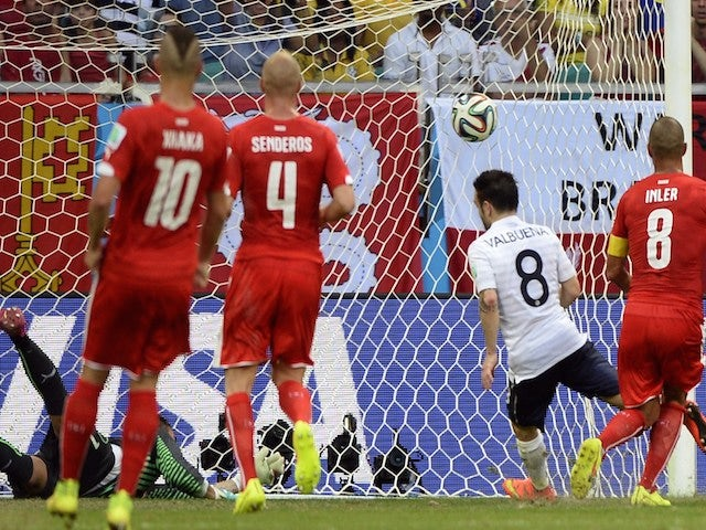 France's midfielder Mathieu Valbuena (2nd R) kicks the ball past Switzerland's goalkeeper Diego Benaglio (back L) to score his team's third goal on June 20, 2014