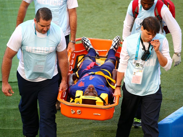 Bruno Martins Indi of the Netherlands is stretchered off the field during the 2014 FIFA World Cup Brazil Group B match between Australia and Netherlands at Estadio Beira-Rio on June 18, 2014