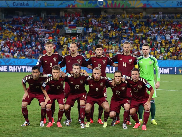 Russia pose for a team photo prior to the 2014 FIFA World Cup Brazil Group H match between Russia and South Korea at Arena Pantanal on June 17, 2014