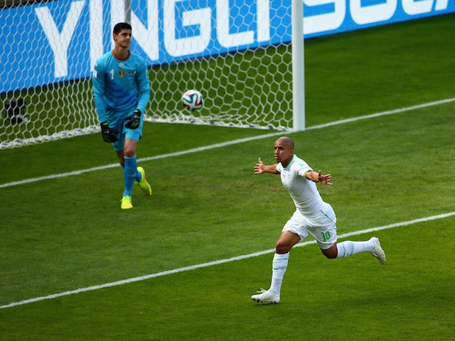 Sofiane Feghouli of Algeria celebrates scoring a penalty during the World Cup Group H match against Belgium in Belo Horizonte on June 17, 2014