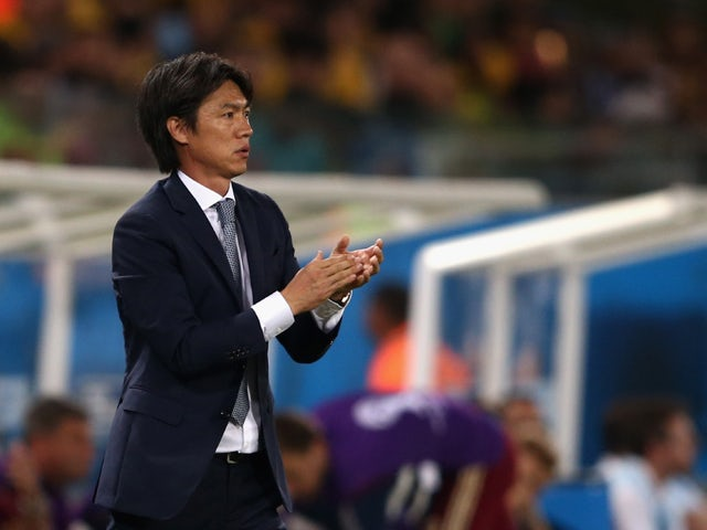 Head coach Hong Myung-Bo of South Korea reacts during the 2014 FIFA World Cup Brazil Group H match between Russia and South Korea at Arena Pantanal on June 17, 2014