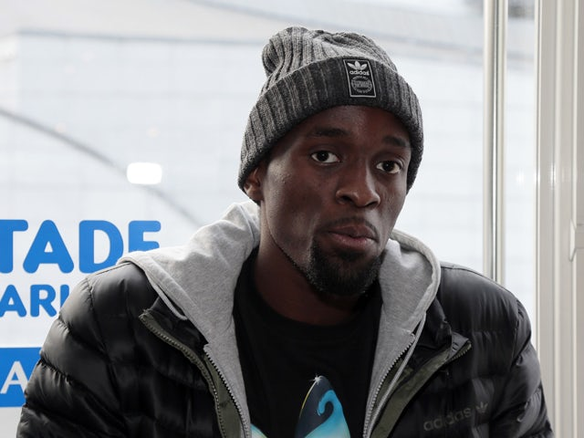 France's world triple jump champion Teddy Tamgho speaks during a press conference on December 13, 2013