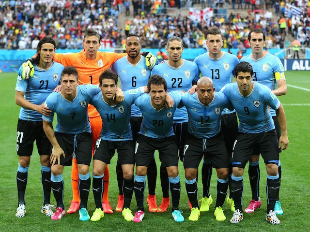 Uruguay pose for a team photo prior to the 2014 FIFA World Cup Brazil Group D match between Uruguay and England at Arena de Sao Paulo on June 19, 2014