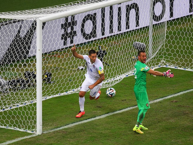 Clint Dempsey of the United States celebrates scoring his team's second goal past Beto of Portugal during the 2014 FIFA World Cup Brazil Group G match between the United States and Portugal at Arena Amazonia on June 22, 2014