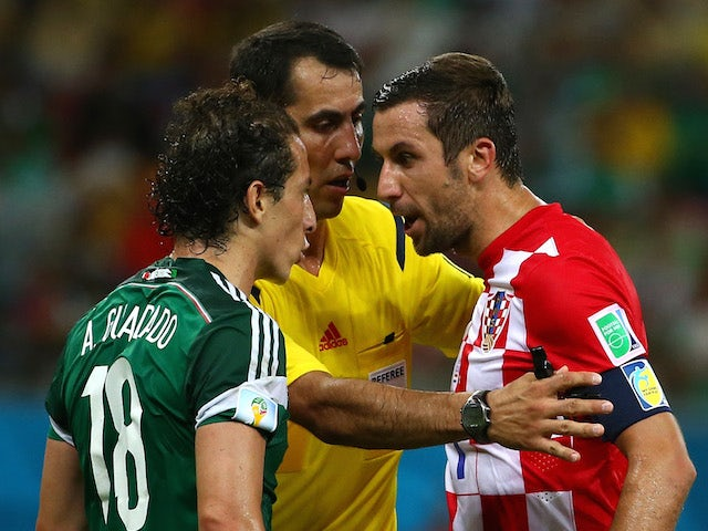 Andres Guardado of Mexico and Darijo Srna of Croatia argue during the 2014 FIFA World Cup Brazil Group A match between Croatia and Mexico at Arena Pernambuco on June 23, 2014