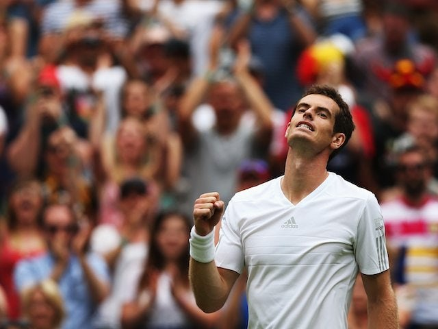 Andy Murray celebrates getting through the first round of Wimbledon on June 23, 2014.