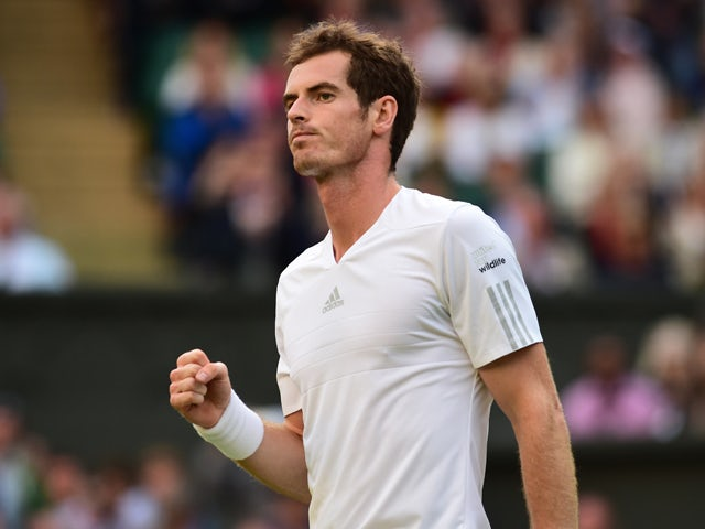 Britain's Andy Murray celebrates winning his men's singles third round match against Spain's Roberto Bautista Agut on day five of the 2014 Wimbledon Championships at The All England Tennis Club in Wimbledon, southwest London, on June 27, 2014