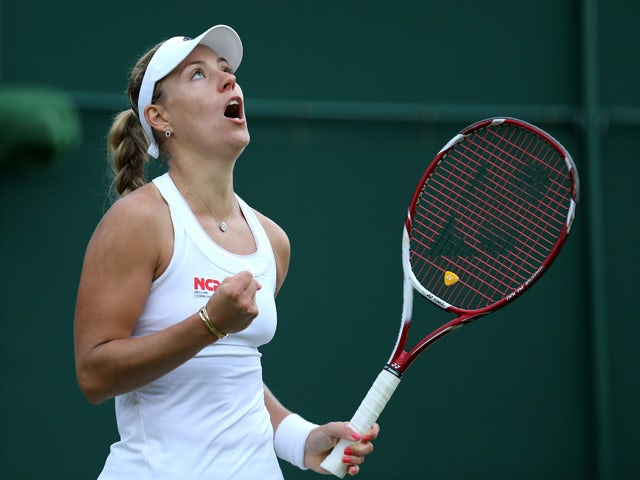 Germany's Angelique Kerber celebrates after winning her women's singles third round match against Belgium's Kirsten Flipkins on day six of the 2014 Wimbledon Championships at The All England Tennis Club in Wimbledon, southwest London, on June 28, 2014