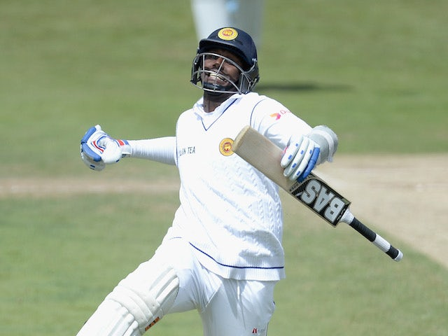 Angelo Mathews of Sri Lanka celebrates reaching his century during day four of 2nd Investec Test match between England and Sri Lanka at Headingley Cricket Ground on June 23, 2014