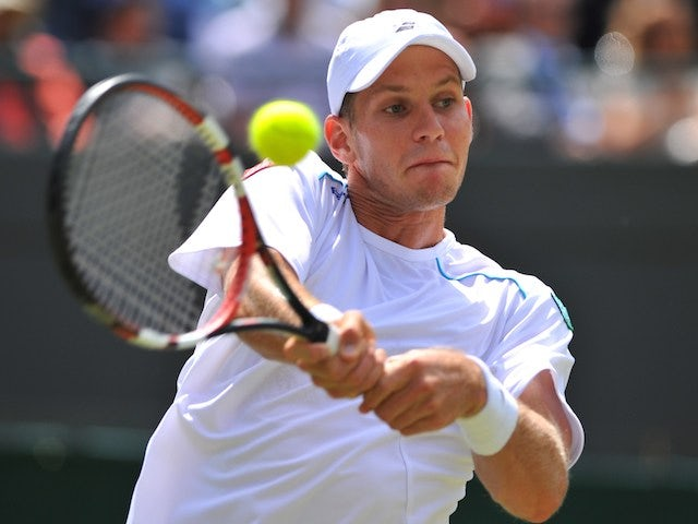 Slovenia's Blaz Rola returns against Britain's Andy Murray during their men's singles second round match on June 25, 2014