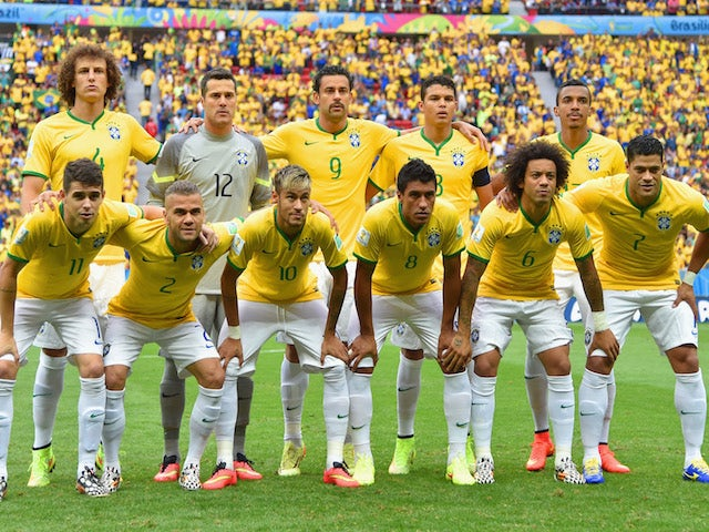 Brazil pose for a team photo prior to the 2014 FIFA World Cup Brazil Group A match between Cameroon and Brazil at Estadio Nacional on June 23, 2014