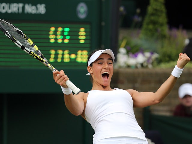 France's Caroline Garcia celebrates winning her women's singles first round match against Italy's Sara Errani on day two of the 2014 Wimbledon Championships at The All England Tennis Club in Wimbledon, southwest London, on June 24, 2014