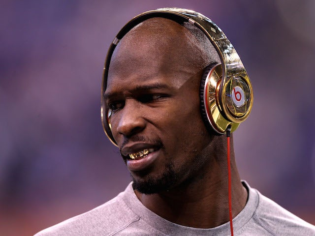 Chad Johnson (Ochocinco) #85 of the New England Patriots waits on the field during warmups before the New England Patriots take on the New York Giants in Super Bowl XLVI on February 5, 2012