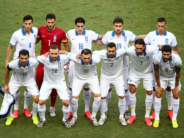 Greece pose for a team photo prior to the 2014 FIFA World Cup Brazil Group C match between Greece and the Ivory Coast at Castelao on June 24, 2014
