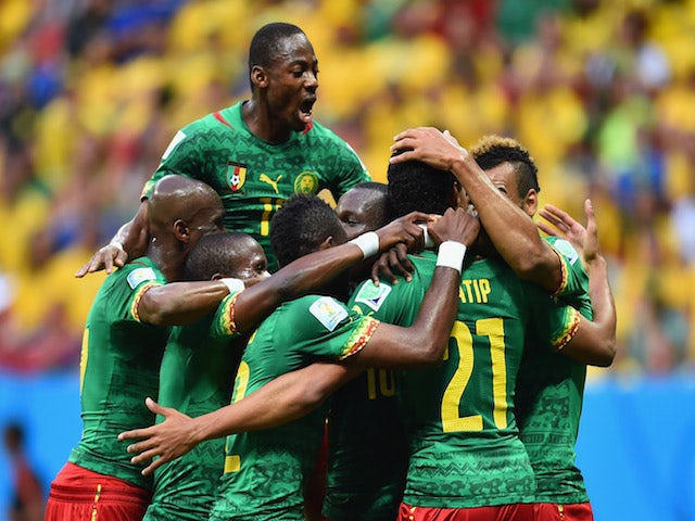Joel Matip of Cameroon (R) celebrates scoring his team's first goal with teammates during the 2014 FIFA World Cup Brazil Group A match against Brazil on June 23, 2014