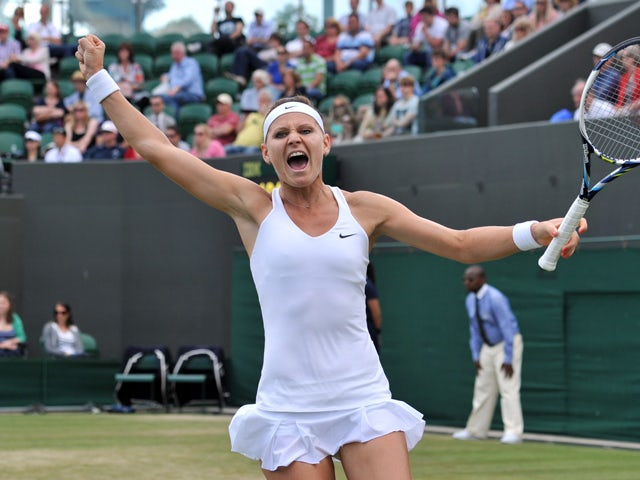 Czech Republic's Lucie Safarova celebrates match point during her women's singles third round match against Slovakia's Dominika Cibulkova on day five of the 2014 Wimbledon Championships at The All England Tennis Club in Wimbledon, southwest London, on Jun