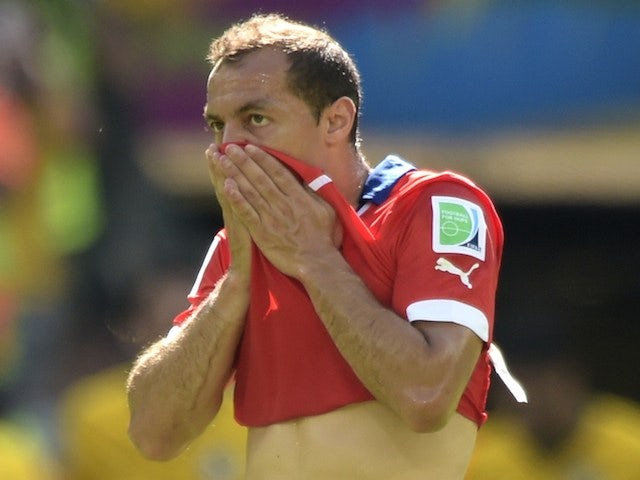 Chile's midfielder Marcelo Diaz reacts after Brazil scored a goal during the Round of 16 football match on June 28, 2014