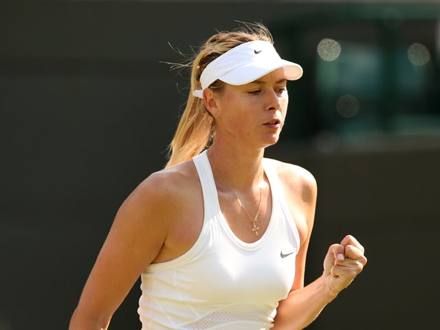 Russia's Maria Sharapova reacts at match point during her women's singles first round match against Britain's Samantha Murray on day two of the 2014 Wimbledon Championships at The All England Tennis Club in Wimbledon, southwest London, on June 24, 2014