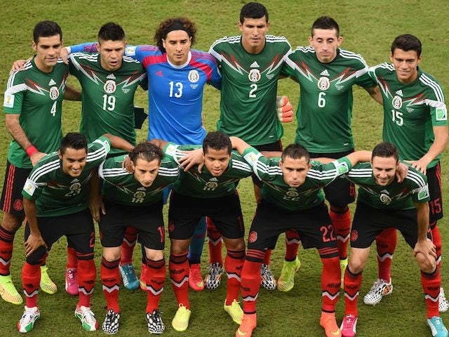 Mexico's players lineup before the game with Croatia on June 23, 2014