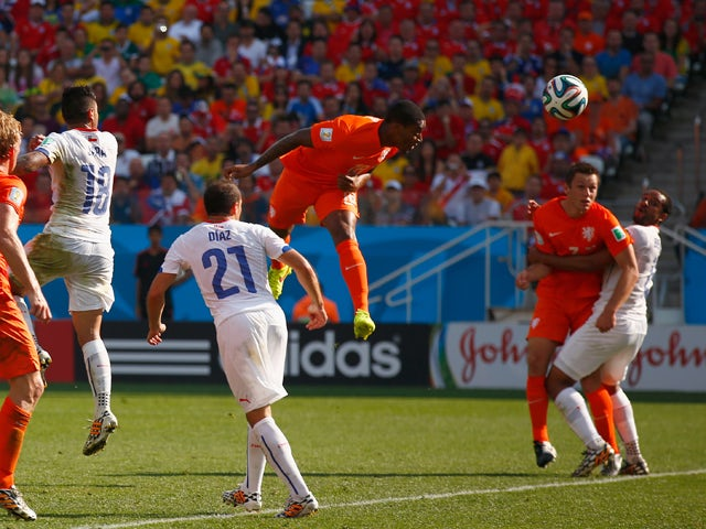 Leroy Fer of the Netherlands scores his team's first goal on a header during the 2014 FIFA World Cup Brazil Group B match between the Netherlands and Chile at Arena de Sao Paulo on June 23, 2014