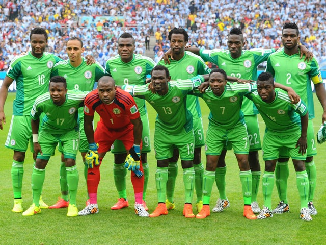 Nigerian footballers pose ahead of the Group F football match between Nigeria and Argentina at the Beira-Rio Stadium in Porto Alegre on June 25, 2014
