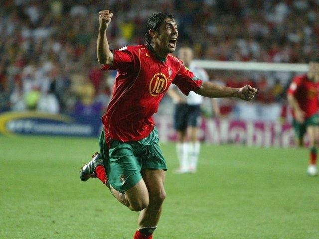 Portgual's Rui Costa celebrates scoring against England on June 24, 2004.