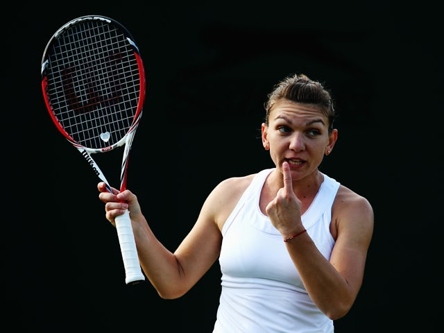 Simona Halep of Romania during her Ladies' Singles third round match against Belinda Bencic of Switzerland on day six of the Wimbledon Lawn Tennis Championships at the All England Lawn Tennis and Croquet Club at Wimbledon on June 28, 2014