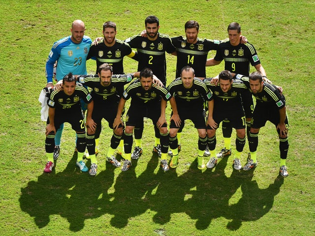 Spain pose for a team photo prior to the 2014 FIFA World Cup Brazil Group B match between Australia and Spain at Arena da Baixada on June 23, 2014