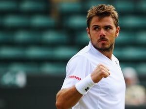 Stanislas Wawrinka of Switzerland celebrates during his Gentlemen's Singles second round match against Yen-Hsun Lu of Chinese Taipei on day four of the Wimbledon Lawn Tennis Championships at the All England Lawn Tennis and Croquet Club at Wimbledon on Jun