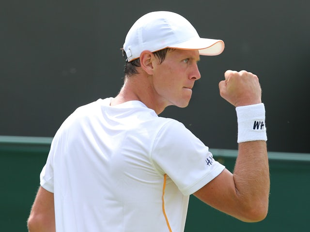 Czech Republic's Tomas Berdych celebrates breaking the serve of Romania's Victor Hanescu during their men's singles first round match on day one of the 2014 Wimbledon Championships at The All England Tennis Club in Wimbledon, southwest London, on June 23,