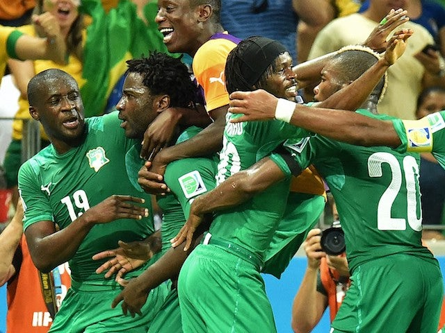 Ivory Coast's forward Wilfried Bony (2nd-L) celebrates with teammates after scoring a goal during the Group C football match against Greece on June 24, 2014