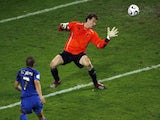 Italian forward Alessandro Del Piero (L) shoots the ball past German goalkeeper Jens Lehmann (R) for his team's second goal in extra time during the World Cup semi-final on July 4, 2006