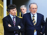 Watford owner Giampaolo Pozzo (C) and son Gino look on during a game between their side and Leeds United on May 4, 2013
