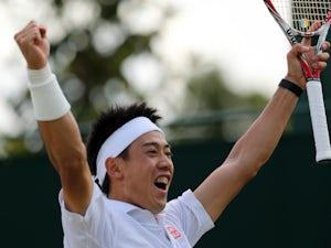 Japan's Kei Nishikori celebrates winning his men's singles third round match against Italy's Simon Bolelli on day seven of the 2014 Wimbledon Championships at The All England Tennis Club in Wimbledon, southwest London, on June 30, 2014