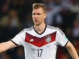 Per Mertesacker of Germany celebrates his team's second goal in extra time during the 2014 FIFA World Cup match against Algeria on June 30, 2014