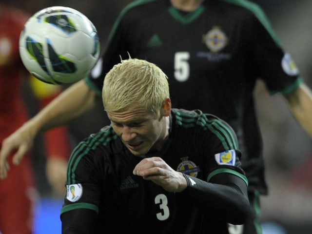 Northern Ireland's defender Ryan McGivern heads the ball during the WC2014 qualifying football match Portugal vs Northern Ireland at the Dragao Stadium in Porto, on October 16, 2012