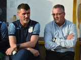 Aston Villa manager Paul Lambert and assistant Roy Keane look on during the pre-season friendly match between Mansfield and Aston Villa at the One Call Stadium on July 17, 2014