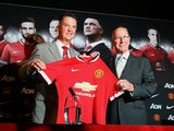 Manchester United's newly-appointed Dutch manager Louis van Gaal poses for pictures with retired English footballer Sir Bobby Charlton during a photocall at Old Trafford in Manchester, north-west England on July 17, 2014