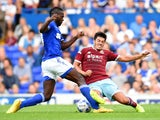 James Tomkins of West Ham United and Frank Nouble of Ipswich Town in action during the pre-season friendly match between Ipswich Town and West Ham United at Portman Road on July 16, 2014
