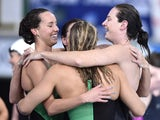 Australia's Bronte Campbell, Australia's Melanie Schlanger, Australia's Emma McKeon and Australia's Cate Campbell celebrate taking gold and a world record in the Women's 4x100m Freestyle Relay final at the Tollcross International Swimming Centre during th