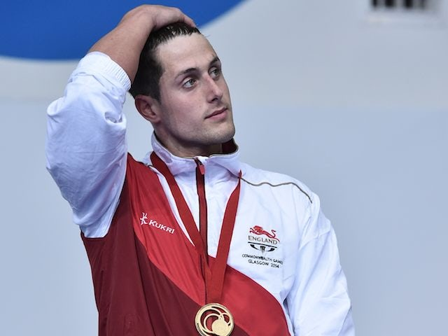 A decidedly broody Chris Walker-Hebborn on the podium after winning gold for England in the men's 100m backstroke on July 25, 2014