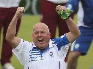 Alex Marshall of Scotland celebrates after winning the Men's Pair Semi-Final match against England at Kelvingrove Lawn Bowls Centre during day four of the Glasgow 2014 Commonwealth Games on July 27, 2014