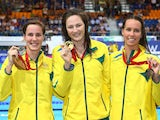 Gold medallist Cate Campbell (C) of Australia poses with silver medallist Bronte Campbell (L) of Australia and bronze medallist Emma McKeon on July 28, 2014