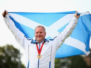 Darren Burnett of Scotland celebrates with his medal after winning the Gold Medal in the Men's Singles Final against Ryan Bester of Canada at Kelvingrove Lawn Bowls Centre during day nine of the Glasgow 2014 Commonwealth Games on August 1, 2014