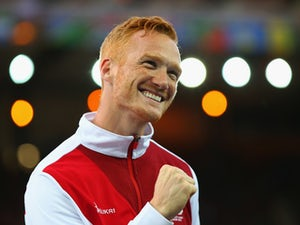 Gold medallist Greg Rutherford of England poses on the podium during the medal ceremony for the Men's Long Jump at Hampden Park during day seven of the Glasgow 2014 Commonwealth Games on July 30, 2014