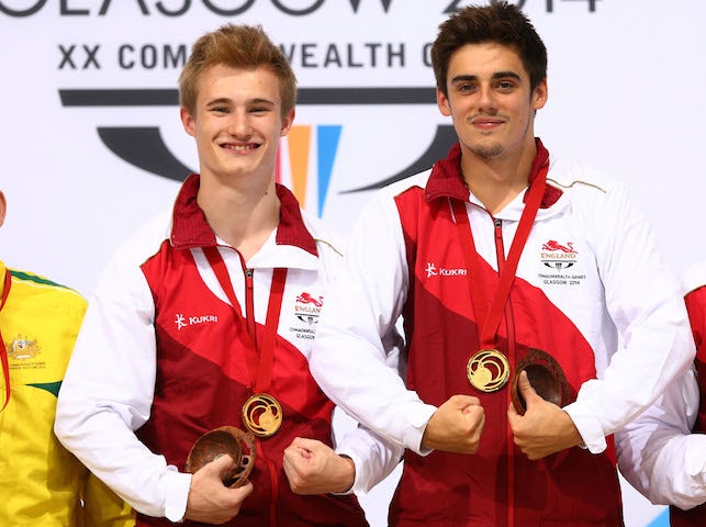 Jack Laugher and Chris Mears of England pose with their gold medals after winning the synchronised 3m springboard event at the Commonwealth Games on August 1, 2014